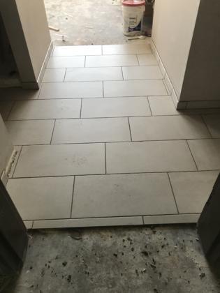 Tile install 6th floor guestroom
